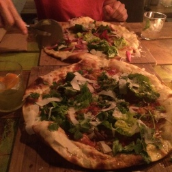 Fresh, crispy pizza (topped with danish bacon, pea sprouts among other things...) from NEIGHBOURHOOD, Copenhagen -not to mention phenomenal cocktails